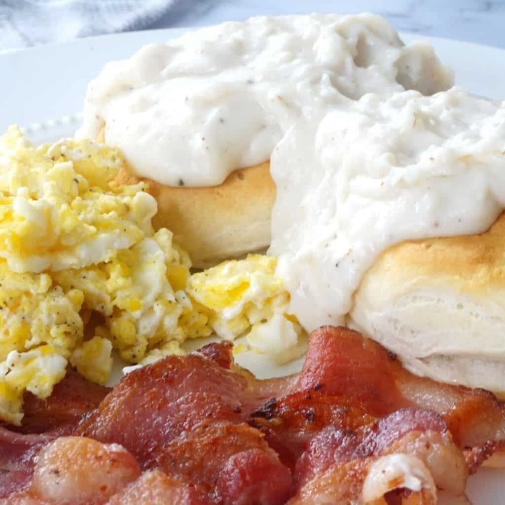 eggs, bacon and biscuits covered in country gravy
