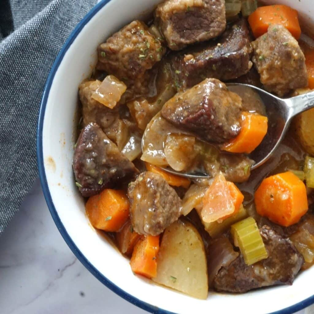 venison beef stew in bowl with carrots and potatoes