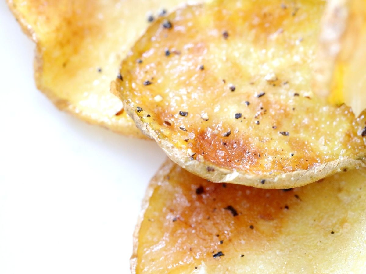 salt and pepper on fried potatoes