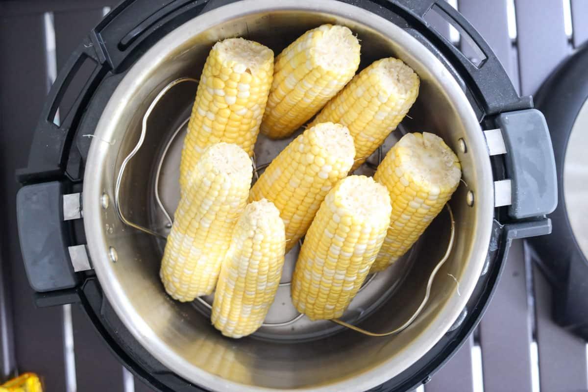 adding corn to the pressure cooker