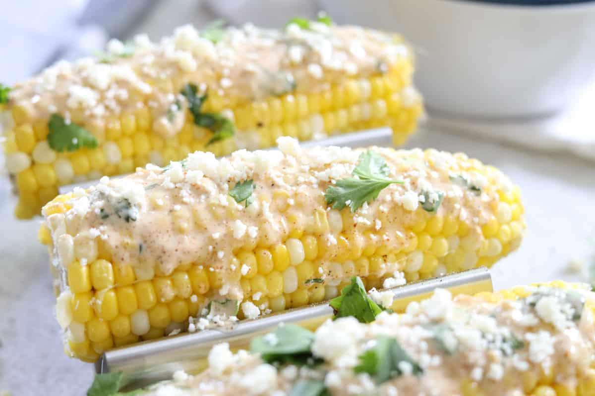 adding cojita cheese to corn