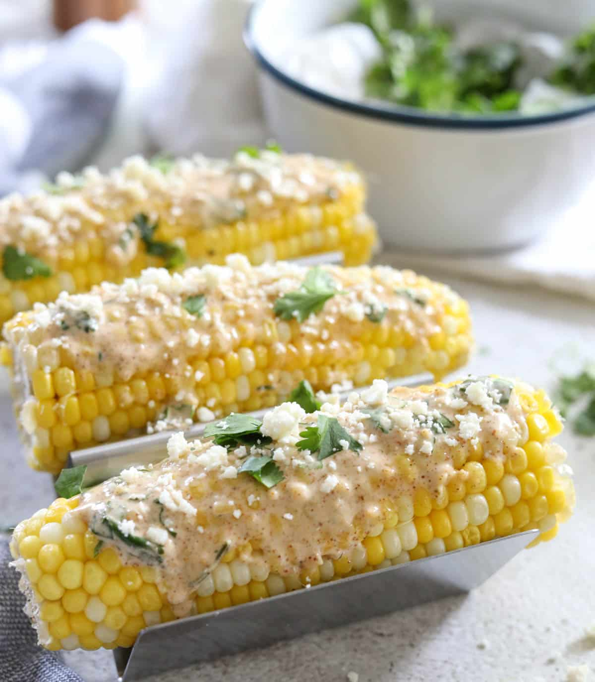 Mexican street corn on table with ingredients