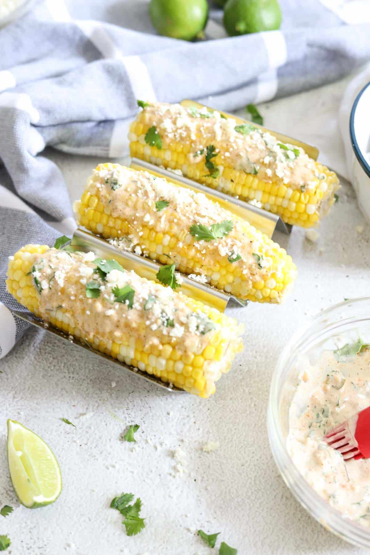 Mexican street corn elote with sauce and cilantro