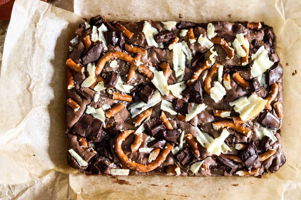 sheet of brownies atop parchment paper