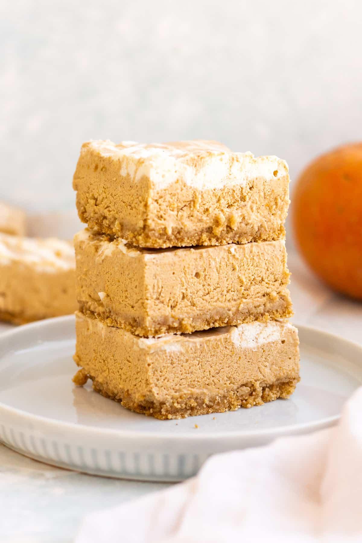 stacked pumpkin pie cheesecake bars