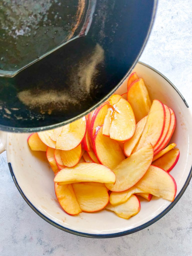 pouring buttery brown sugar onto apple slices
