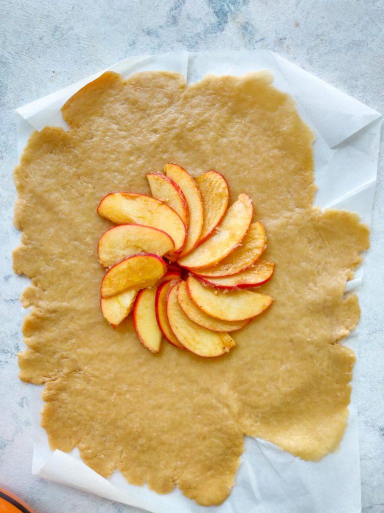 beautiful apple slices arranged on galette crust