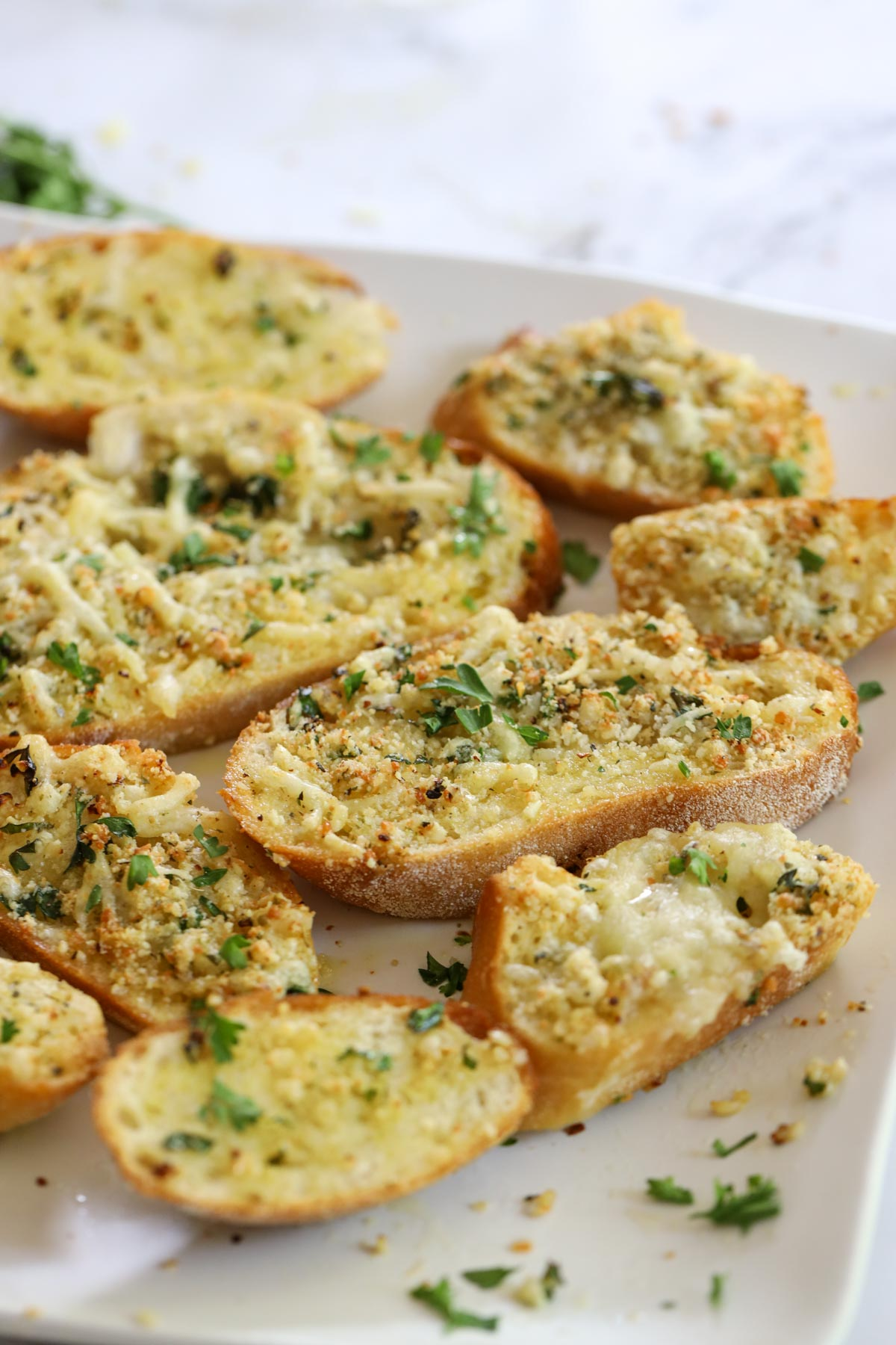 pieces of garlic bread lying on a plate