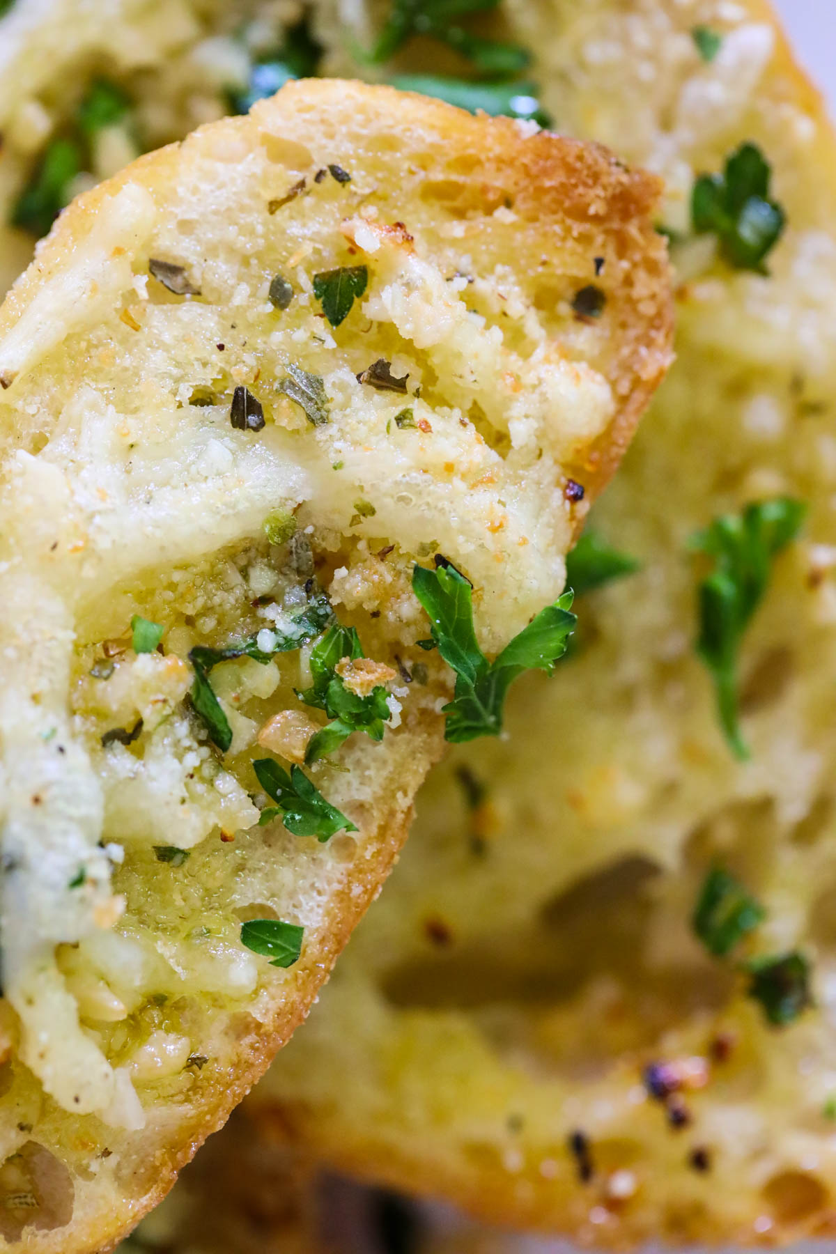close up of garlic bread with cheese and Italian seasoning blend