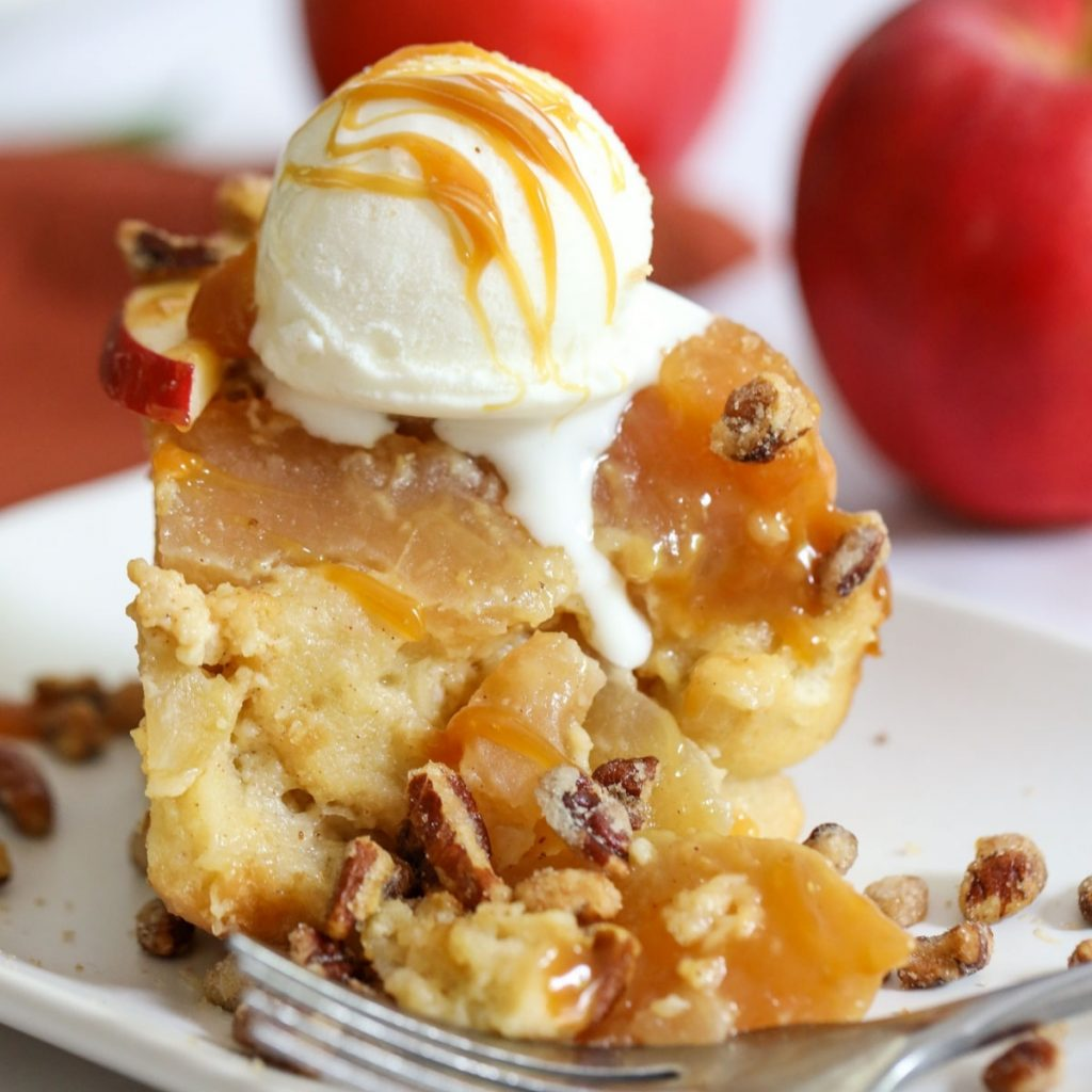 apple bread pudding with nut topping and ice cream dripping down the side