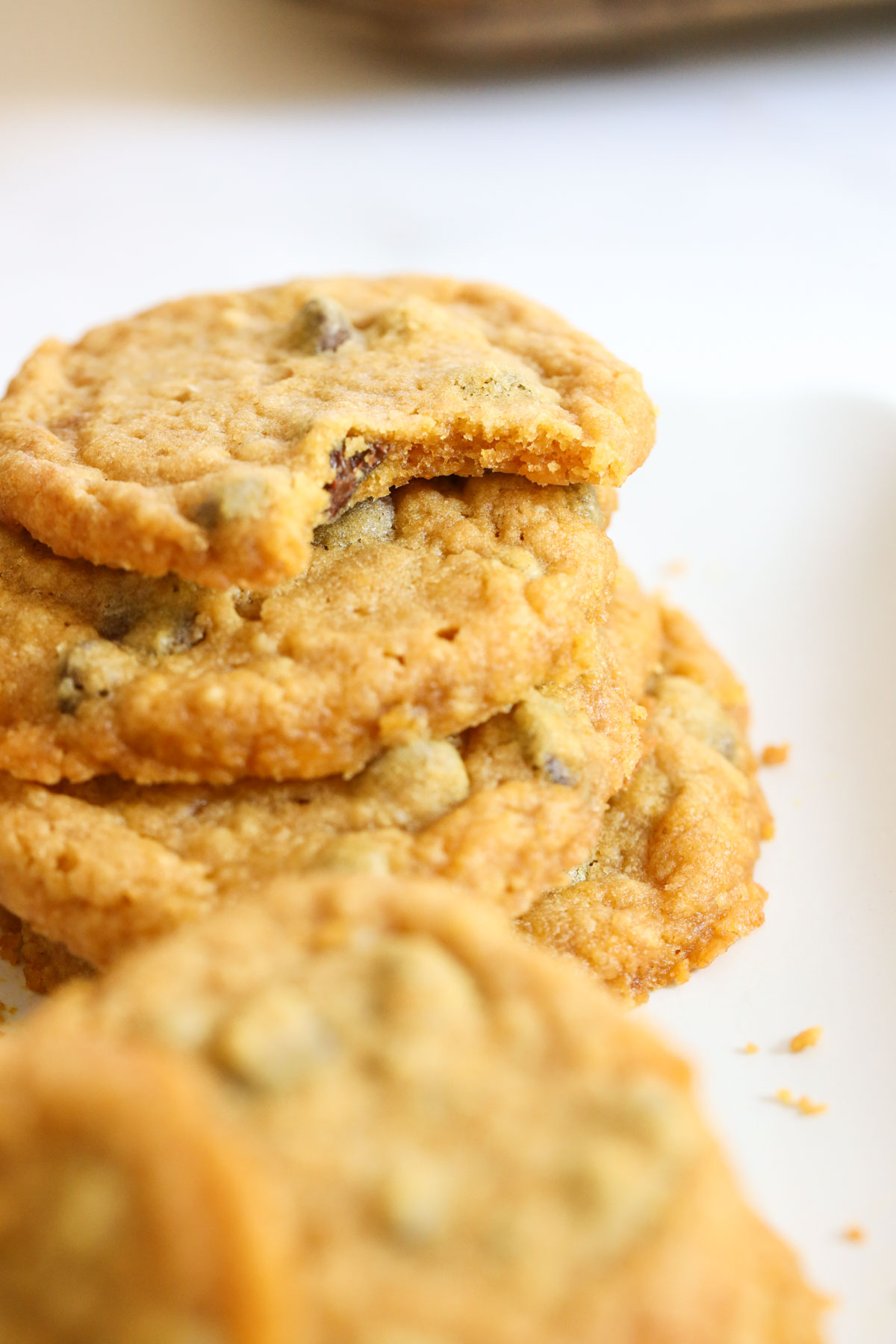 Pumpkin cookies stacked with a bite taken from one on top