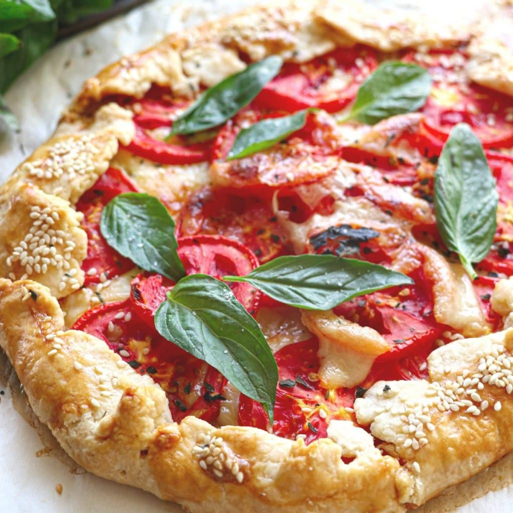 tomato galette with fresh basil and melted mozzarella
