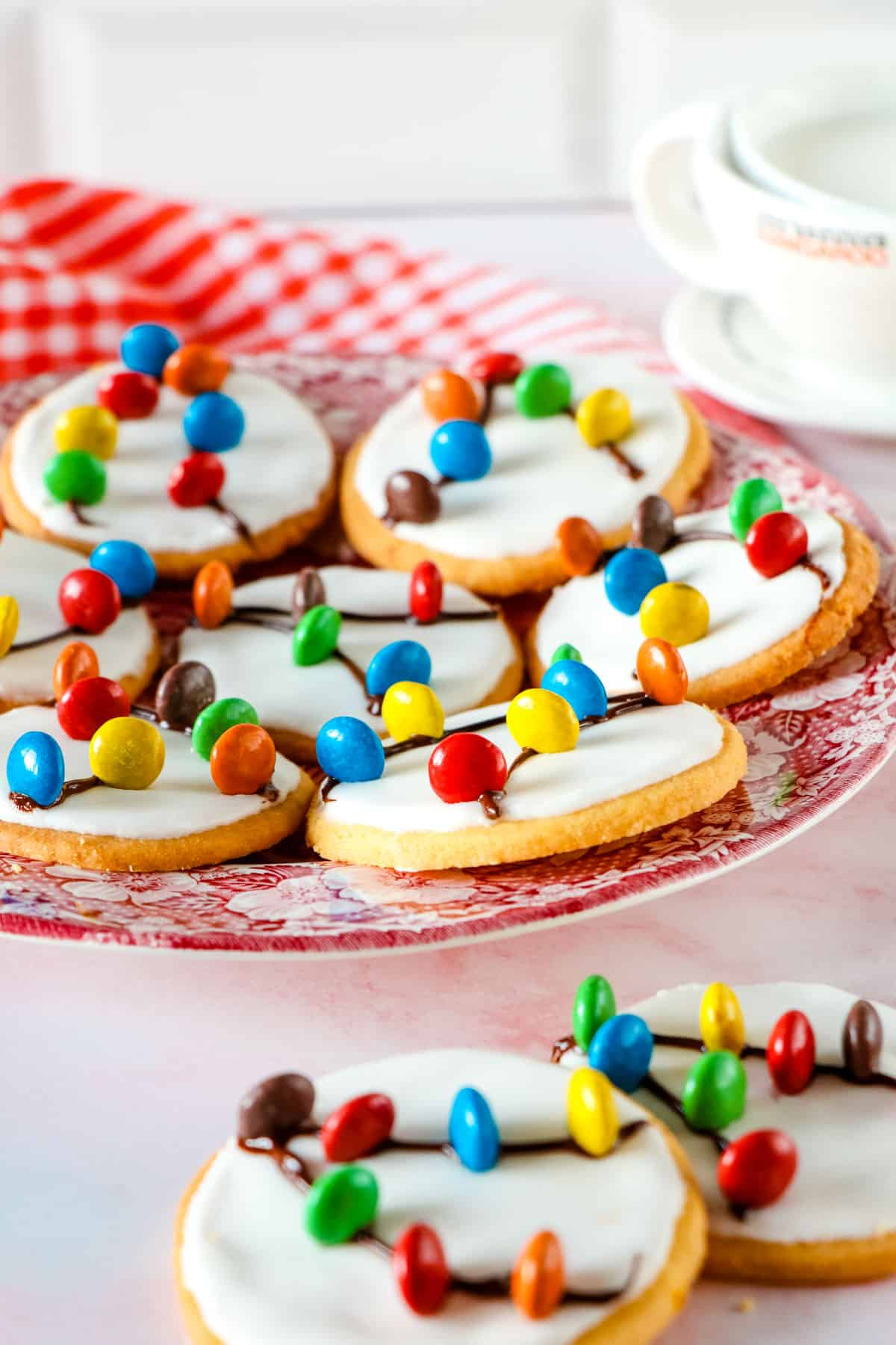 iced sugar cookies decorated with m and m's and frosting to look like Christmas lights