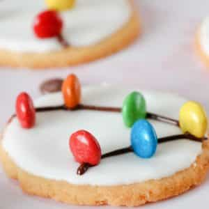 christmas light cookies with frosting and m&ms on top