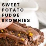 hand holding gooey sweet potato fudge brownies