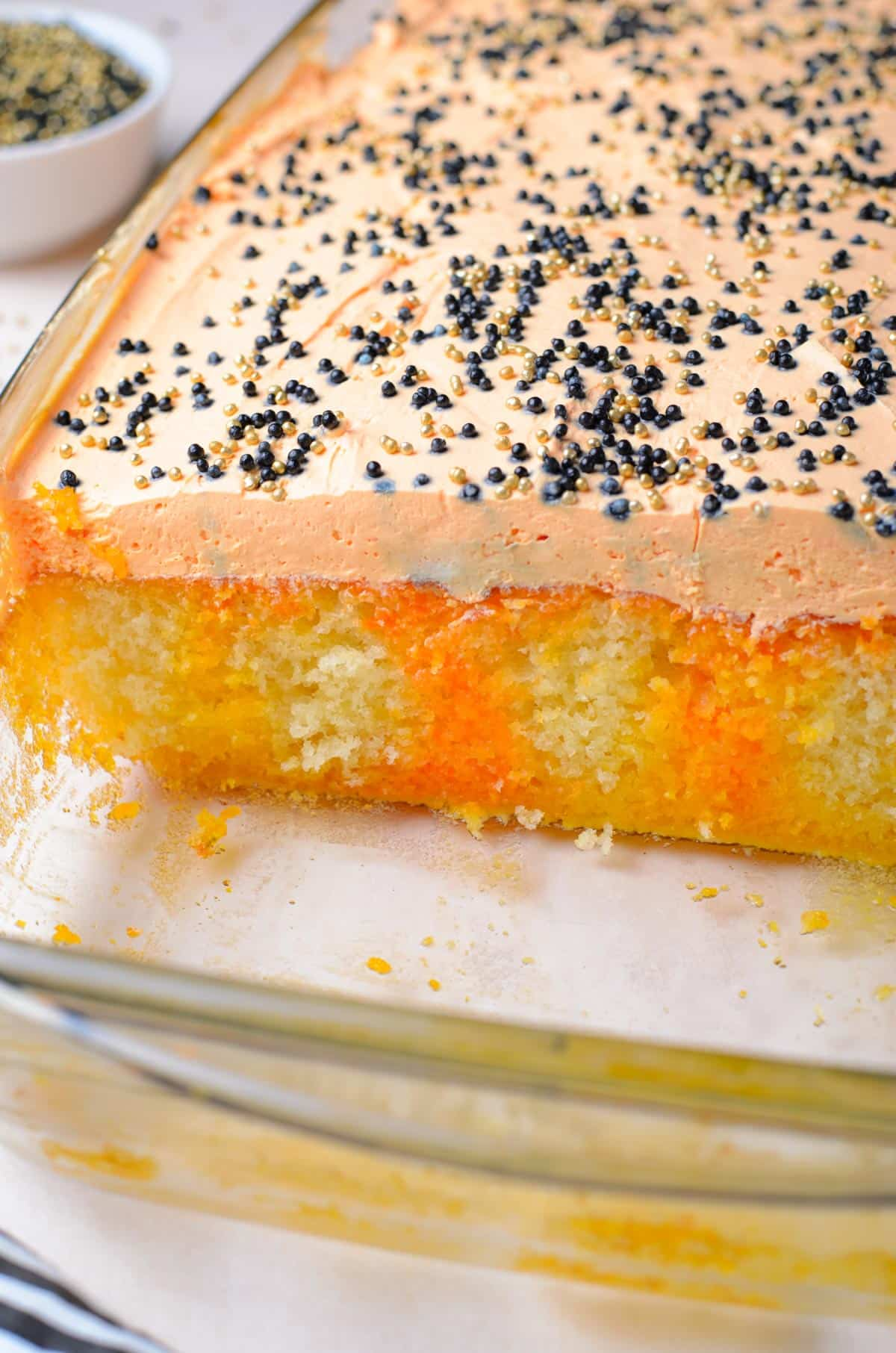 inside of a baked poke cake with layers of orange
