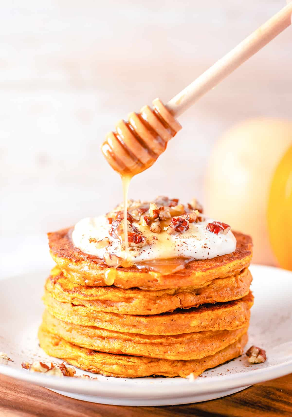 pumpkin pancakes with syrup on top