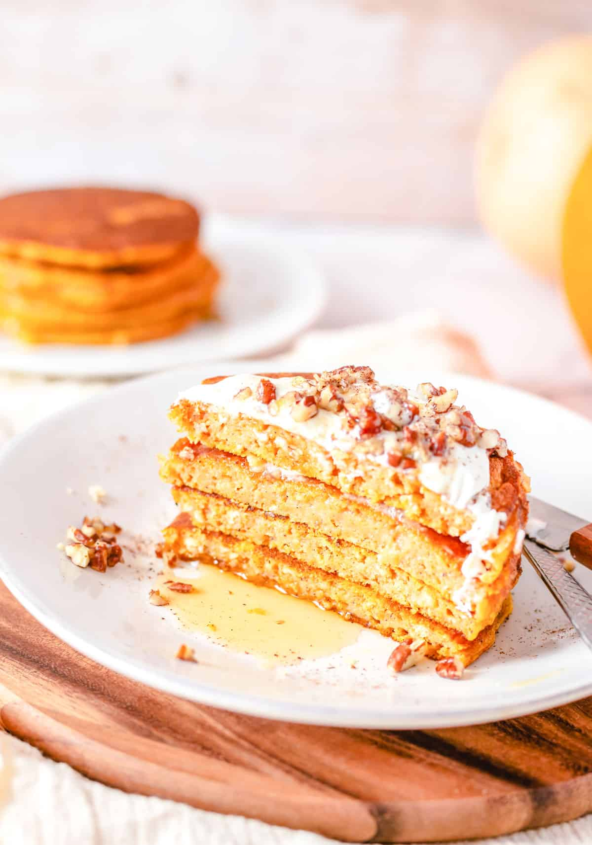 sliced gooey pumpkin pancakes with frosting