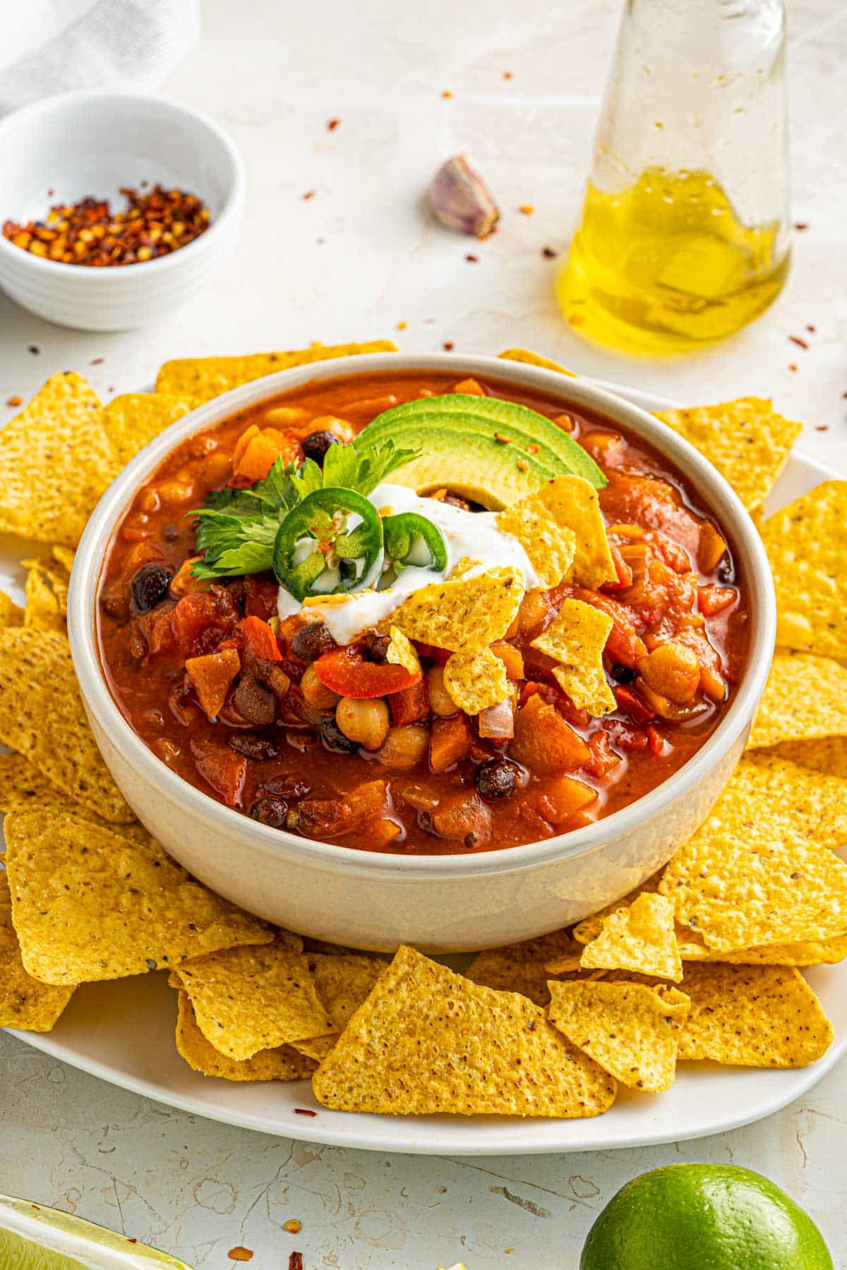 vegetarian smoky chili with tortilla chips, sour cream and avocado toppings