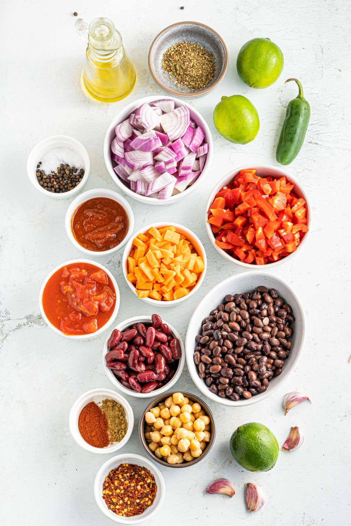 vegetarian smoky chili ingredients including black beans, chickpeas, peppers, kidney beans and spices