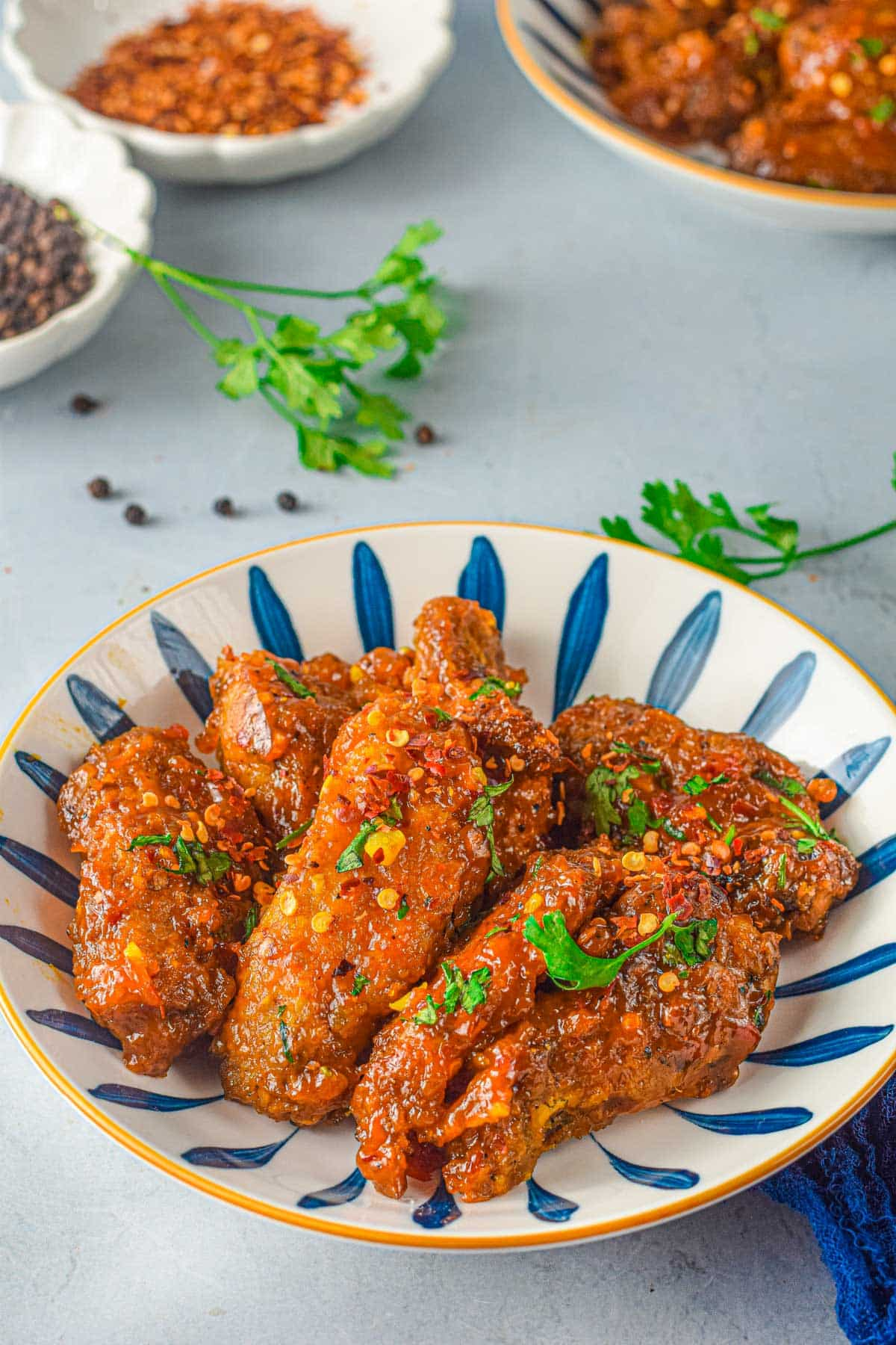sweet chili air fryer wings with red pepper flakes